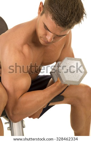 a man doing arm curls with his weights.