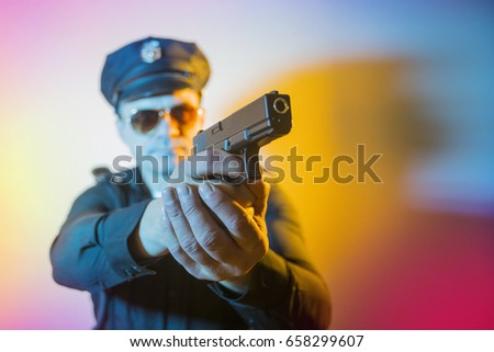 a man dressed in a police costume USA, COP is holding a gun