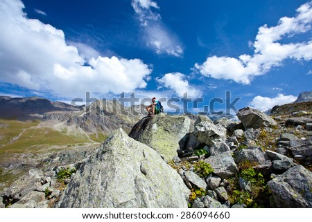 A man enjoys the view of the glacier and the lake