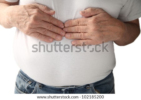a man feels pressure in the center of his chest - stock photo