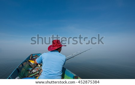 A man fishing in the boat