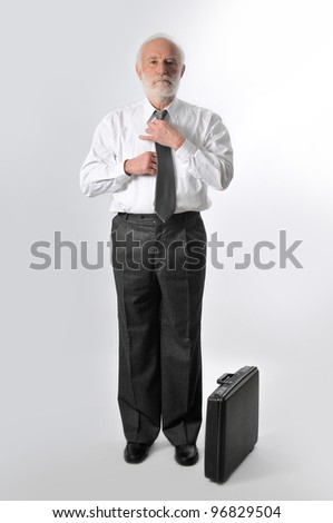 a man fixes his tie - stock photo