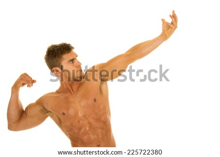 A man flexing his arms and body without a shirt on. - stock photo