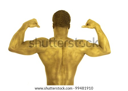A man flexing his back muscles his skin is gold. - stock photo