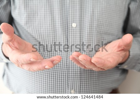 a man gestures with both hands
