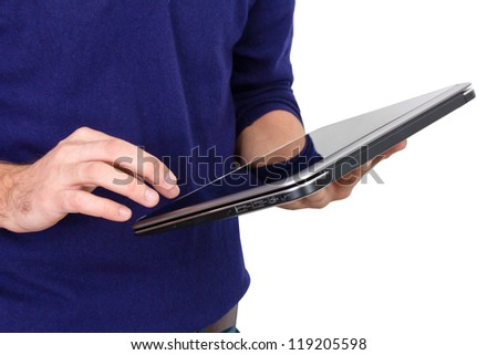 a man gets on the hip opened laptop - stock photo
