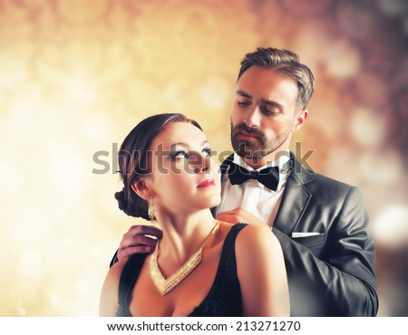 A man gives a necklace to his wife - stock photo