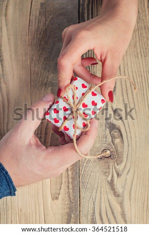 a man gives a woman a gift to the day of lovers. Valentine's day