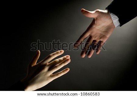 a man giving a friendly helping hand - stock photo