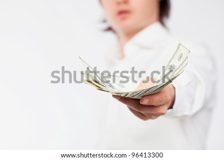 A man giving a handful of dollars. - stock photo