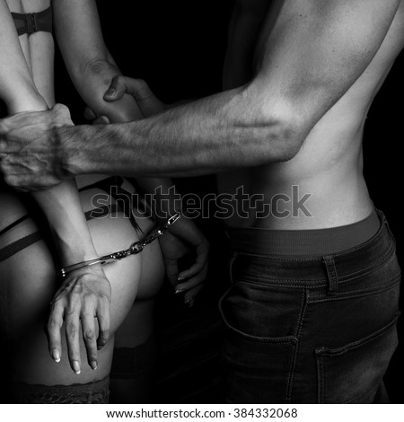 A man grab a woman from behind - stock photo