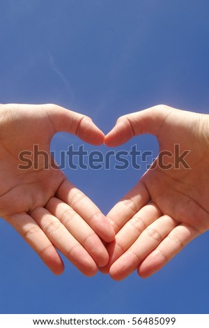 A man hand forming a heart - stock photo