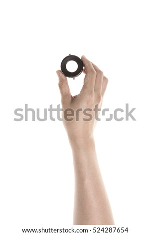A man hand hold a vintage(old) film lupe isolated white.