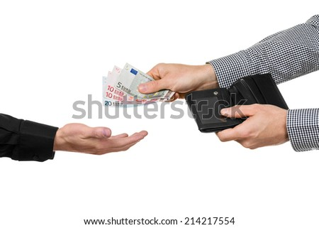 A man hands over 45 Euro from a black wallet. - stock photo