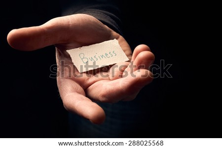 A man holding a card with a hand written message on it, Business. - stock photo