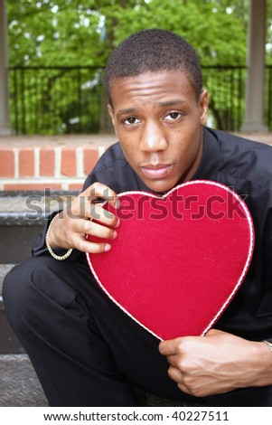 A man holding a heart shaped box