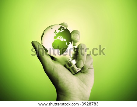 A man holding a light bulb with the world lighting up. - stock photo