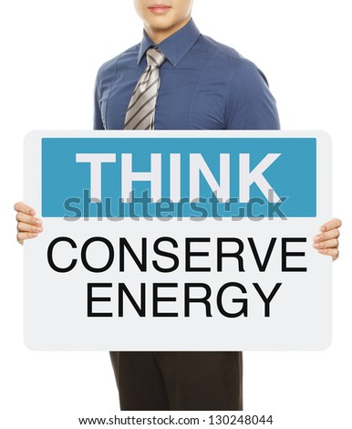 A man holding a signboard on energy conservation - stock photo