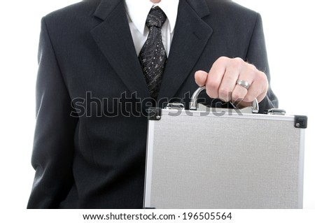 A man holding a silver case in his hand.