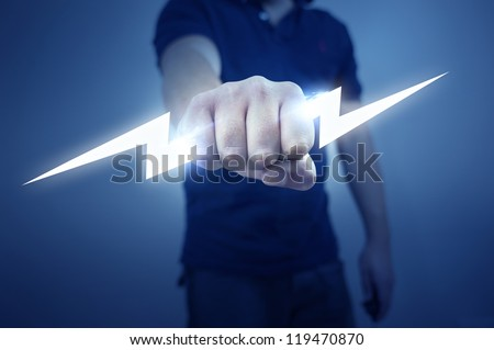 A man holding a stylized electric bolt. - stock photo