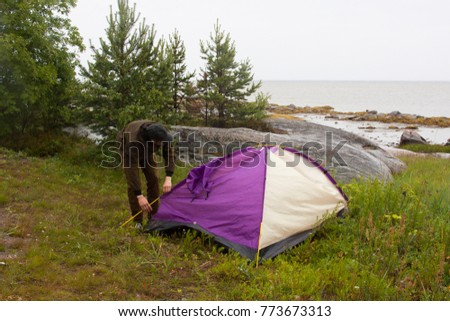 A man holding a tent in the forest not far away from sea & Man Holding Tent Forest Not Far Stock Photo 773673313 - Shutterstock