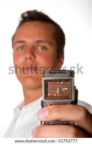A man holding a wrist watch