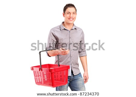 A man holding an empty shopping basket isolated on white background
