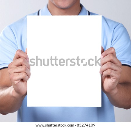A man holding blank paper - stock photo