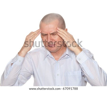 A man holding hands on his head because of migraine. Isolated on white.