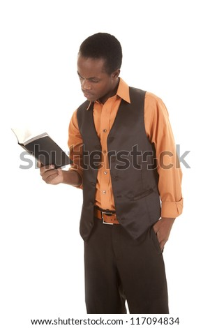 A man holding on to a book reading. - stock photo