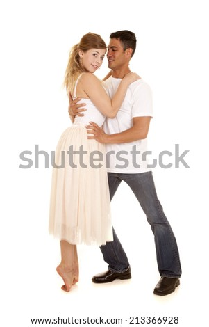 A man holding on to his dancer while she is on her toes. - stock photo