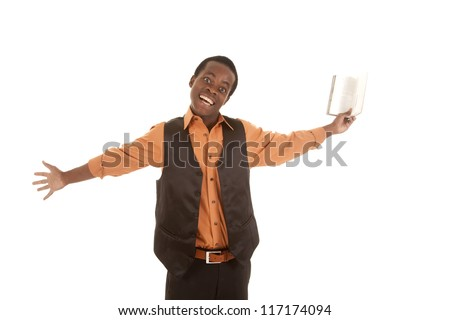 A man holding out his book with an excited expression on his face. - stock photo