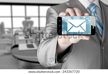 A man holding smartphone with one new message on a screen. Closeup shot. - stock photo