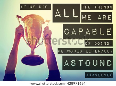 a man holding up a gold trophy cup toned with a retro vintage filter app or action effect with the text: if we did all the things we are capable of doing we would literally astound ourselves - stock photo