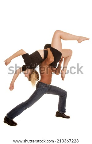 A man holding up his woman in a over the shoulder dance move.