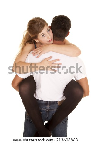 a man holding up his woman in his arms with the woman looking over his shoulder.