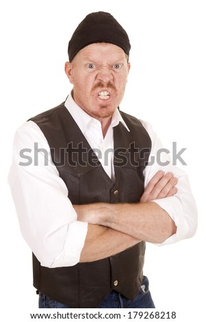 A man in a bandanna is very mad with his arms folded. - stock photo