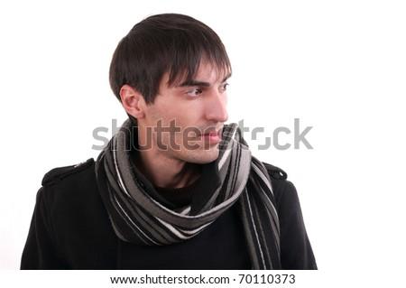 A man in a black coat ponders looking sideways - stock photo