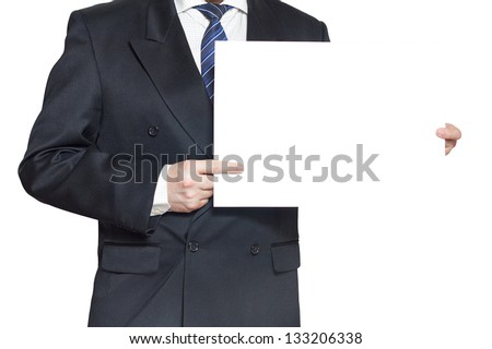 A man in a black suit holding a blank paper in the hands isolated on white background horisontal - stock photo