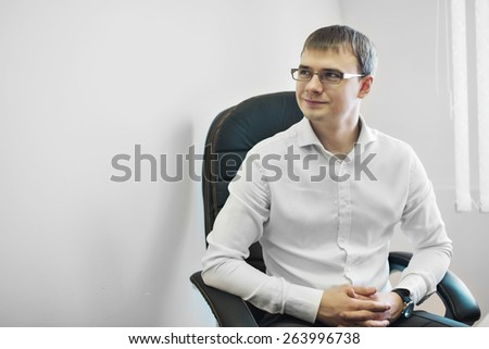 a man in a business suit works in the office - stock photo