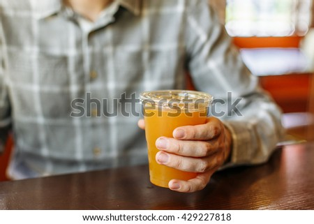 a man in a cafe drinking tea at the table happy
