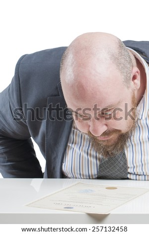 A man in a jacket carefully studying the document. In isolation.