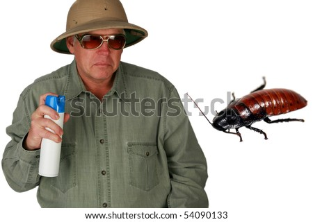 "a man in a pith helmet sprays Bug Spray towards a giant cockroach with ""dont bug me"" text isolated on white with room for your text or images (text can easily be removed and replaced by your own) - stock photo"