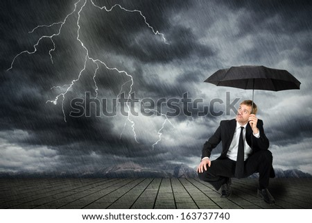 a man in a suit and umbrella seeks shelter from flashes and rain