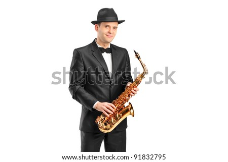 A man in a suit holding a saxophone isolated on background - stock photo