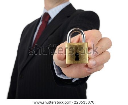 A man in a suit holding to camera a padlock a concept of security - stock photo