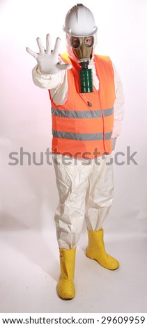 a man in a white hazmat suit, orange safety vest, and hard hat, and a gasmask holds his hand out to stop traffic representing the current Mexican Swine Flu Pandemic