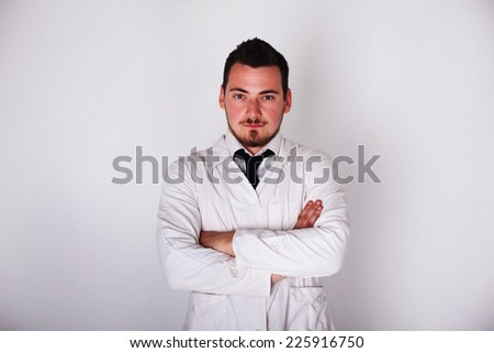 a man in a white robe holding hands crossed on his chest - stock photo