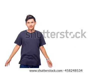 A man in blue shirt swings his hand. - stock photo