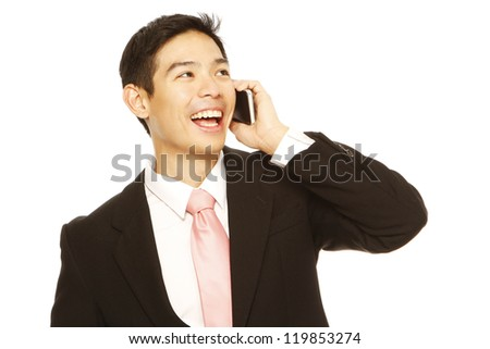 A man in business attire holding a mobile phone - stock photo